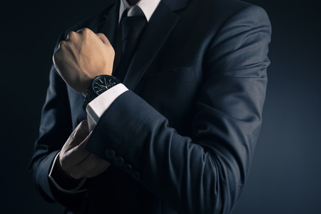 Businessman Fixing Cufflinks his Suit Stockfoto