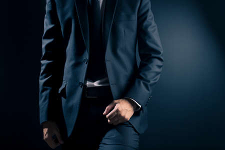 businessman suit: Businessman in Black Suit on Isolated Background