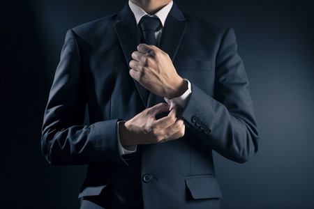 suit  cuff: Businessman Fixing Cufflinks his Suit Stock Photo