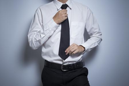 wrist cuffs: Businessman adjusting his tie Stock Photo