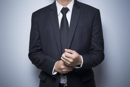 adjusting: Businessman adjusting his cufflinks Stock Photo