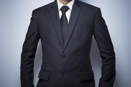 informal clothing: Businessman informal akimbo action