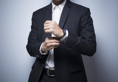wrist cuffs: Businessman adjusting his cufflinks Stock Photo