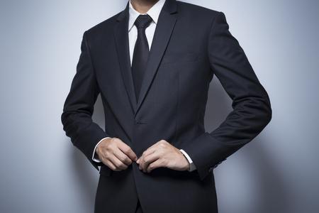 wrist cuffs: Businessman Dressing Up a Black Suit