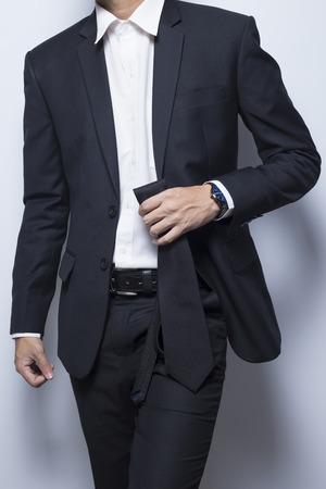 wrist cuffs: Businessman hold his necktie