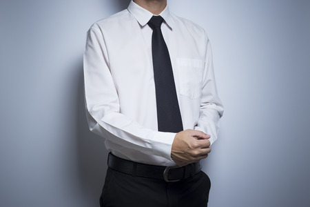 suit  cuff: Businessman adjusting his cufflinks Stock Photo