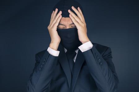 failed plan: Businessman Wearing a Balaclava Thinking Corruption Plan but He Failure