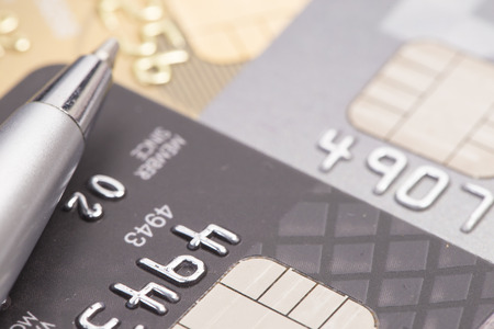 bankcard: Money management and finance concept, pen and credit card Stock Photo