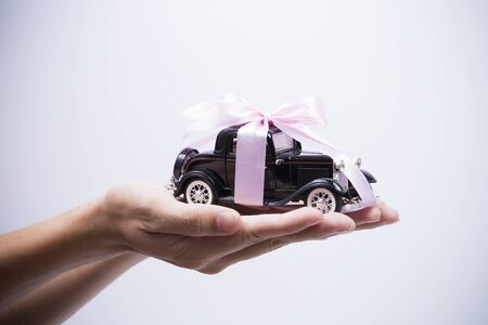 Model of car on hands
