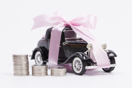 Loan Finance Concepts, toy car and coin with isolated background
