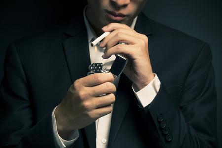 bad leadership: Businessman smoking a cigarette