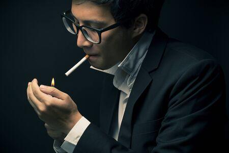 work addicted: Businessman smoking a cigarette