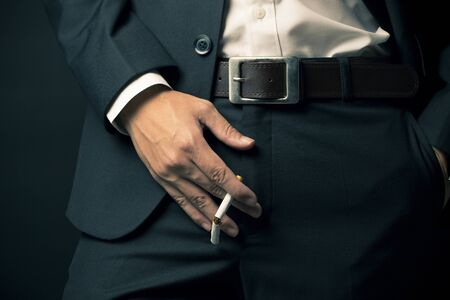 dysfunction: Sexual Dysfunction concept, Businessman smoking a cigarette