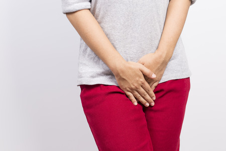 Woman with hands holding her crotch Standard-Bild