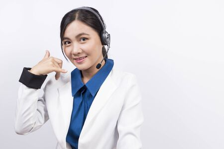 headset symbol: Operator in headset and she make her hand be telephone symbol Stock Photo