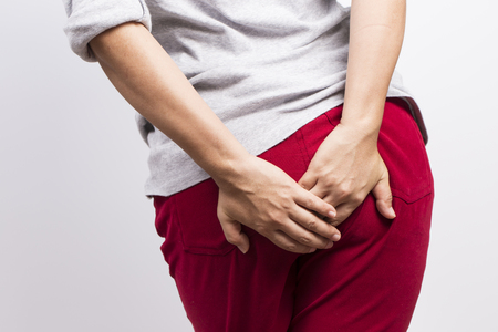 diarrhea: Woman has diarrhea and holding her butt