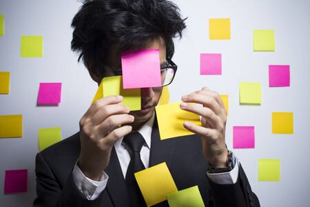 forgetful: Busy businessman with notepaper