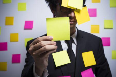 notepaper: Businessman show a notepaper