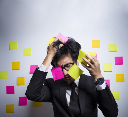 notepaper: Busy businessman with notepaper