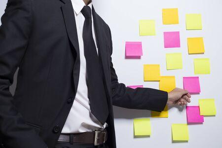 notepaper: Businessman holding a notepaper