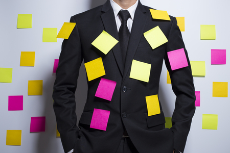 forgetful: Businessman with notepaper