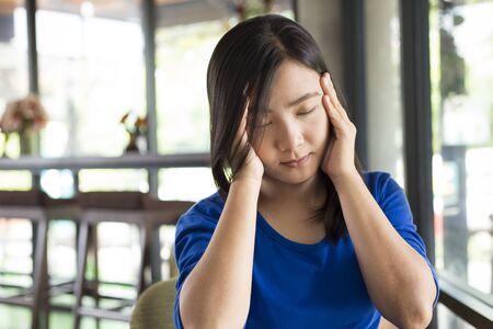 splitting headache: Woman has headache in the cafe Stock Photo