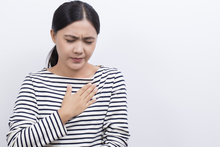 acid reflux: Woman with symptomatic acid reflux