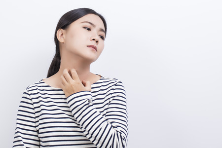 atopic: Woman scratching her neck Stock Photo