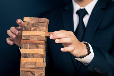 builds: Businessman Builds a Tower Stock Photo