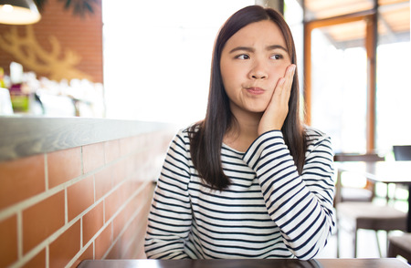 tooth ache: Woman has tooth ache Stock Photo