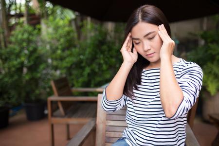 splitting headache: Woman has head ache at coffee shop Stock Photo