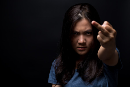 surly: Angry woman show her middle finger Stock Photo