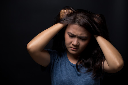 Angry woman on isolated black background Stock Photo