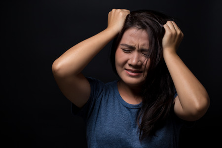 surly: Angry woman on isolated black background Stock Photo