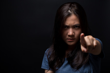 Angry woman pointing to front Stock Photo
