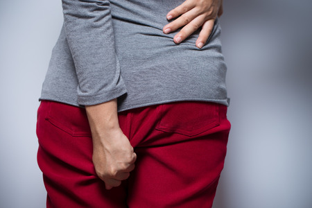 Woman has diarrhea and holding her butt Imagens - 64839083