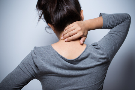 Woman has neck pain Stock Photo