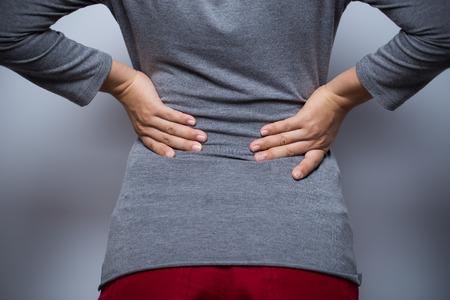 Woman has waist pain Stock Photo