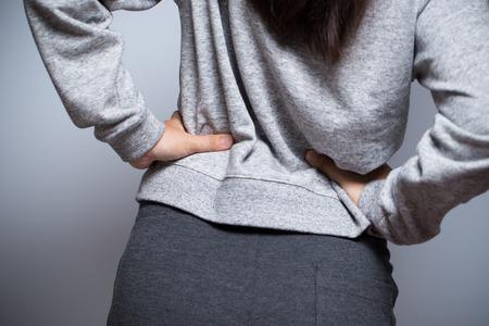 waist: Woman has waist pain Stock Photo