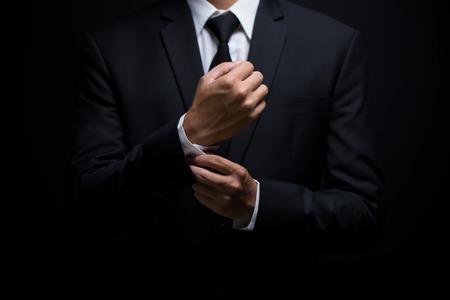 Businessman adjusting his cufflinks Foto de archivo