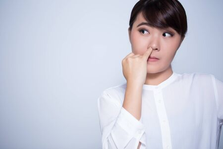 nose picking: Woman is picking his nose Stock Photo