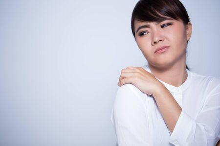 tiredness: Woman has shoulder pain Stock Photo