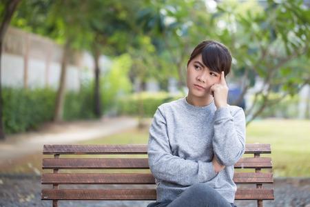 thinking woman: Woman thinking at park Stock Photo