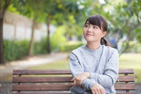 thinking woman: Happy woman thinking at park Stock Photo