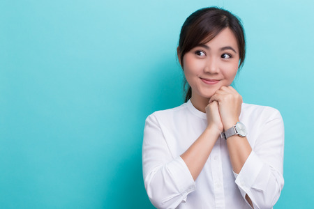 thinking woman: Asian woman thinking and happy