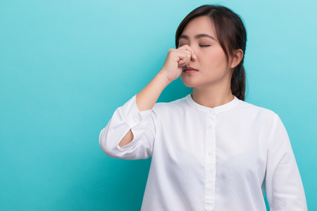 Woman touch her nose