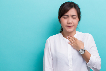 Woman has sore throat Stock Photo - 71387434