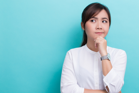 Asian woman thinking on isolated background