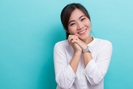 Asian woman thinking and happy