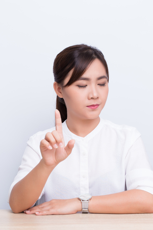 Woman making stop symbol in the office Stock Photo
